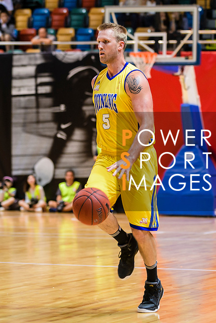 Hosford Ian Daniel #5 of Winling Basketball Club handles the ball against the Tycoon during the Hong Kong Basketball League playoff game between Winling and Tycoon at Queen Elizabeth Stadium on July 24, 2018 in Hong Kong. Photo by Marcio Rodrigo Machado / Power Sport Images