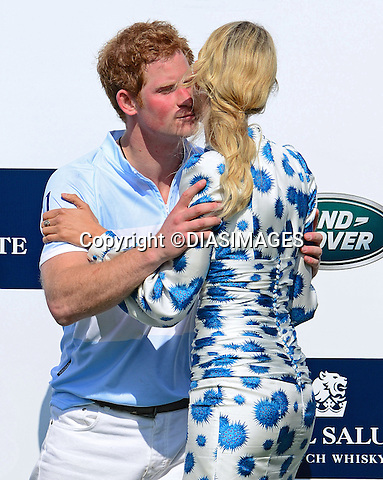 """PRINCE HARRY KISSES KAROLINA KURKOVA.during the presentation ceremony for the Sentabale Charity Polo Match at the Greenwich Polo Club, Conneticut_15/05/2013.Prince Harry is on a week long USA visit the includes Washington, Denver, Colorado Springs, New Jersey, New York and Conneticut..Mandatory credit photo:©DIASIMAGES..NO UK USE UNTIL 11/06/2013.(Failure to credit will incur a surcharge of 100% of reproduction fees)..**ALL FEES PAYABLE TO: """"NEWSPIX  INTERNATIONAL""""**..Newspix International, 31 Chinnery Hill, Bishop's Stortford, ENGLAND CM23 3PS.Tel:+441279 324672.Fax: +441279656877.Mobile:  07775681153.e-mail: info@newspixinternational.co.uk"""
