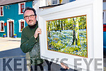 Artist Mark Eldred with his oil painting 'Wild Garlic Bluebells' which he has donated to the Glenflesk/Kilcummin GAA clubs Night at the Oskars
