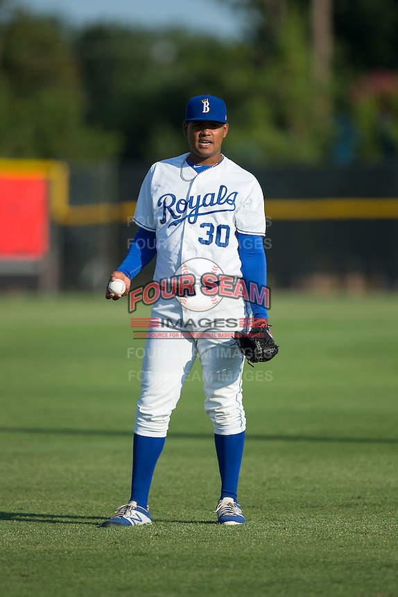 Burlington Royals pitcher Igol Feliz (30) warms up in the outfield prior to the game against the Bluefield Blue Jays at Burlington Athletic Park on June 29, 2015 in Burlington, North Carolina.  The Royals defeated the Blue Jays 4-1. (Brian Westerholt/Four Seam Images)