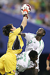 15 July 2007: Chile goalkeeper Cristopher Toselli (left) claims a ball in the penalty area over Nigeria's Bello Kofarmata (7) and Akeem Agbetu (11). Chile's Under-20 Men's National Team defeated Nigeria's Under-20 Men's National Team 4-0 after extra time in a  quarterfinal match at Olympic Stadium in Montreal, Quebec, Canada during the FIFA U-20 World Cup Canada 2007 tournament.