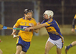 Patrick Maher moves in to tackle Clare's Domhnall O' Donovan. Photograph by Declan Monaghan