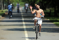 A young man cycles by the coastal path enjoying the sunshine in Swansea, Wales, UK Friday 13 May 2016