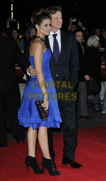 Livia Giuggioli & Colin Firth .attended the 'Rolling Stones: Crossfire Hurricane' American Express gala screening, the 56th BFI London Film Festival day 9, Odeon Leicester Square cinema, Leicester Square, London, England, 18th October 2012..full length dress blue black choker lace necklace strapless grey gray suit tie hand in pocket husband wife couple ankle boots clutch bag shoes heels  side .CAP/CAN.©Can Nguyen/Capital Pictures.