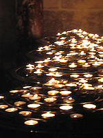 Ring of prayer candles at Notre Dame