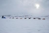 Sebastian Schnuelle in Ptarmigan valley in the Alaska Range on his way to Rohn during Iditarod 2009