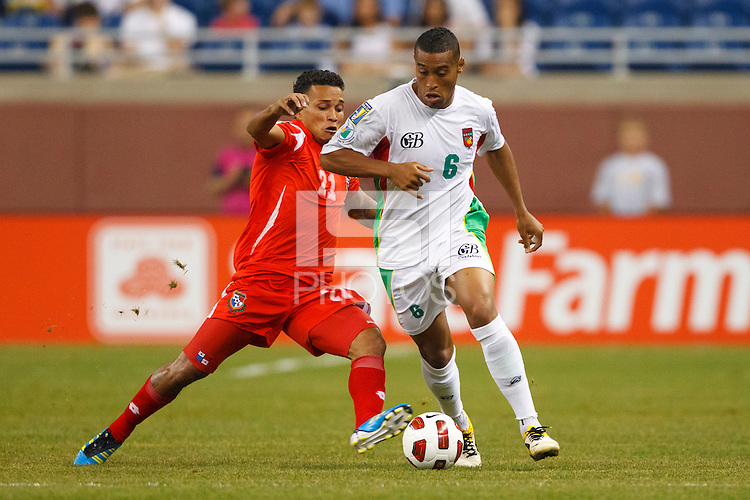 7 June 2011: Panama midfielder Amilcar Henríquez (21) and Guadeloupe midfileder David Fleurival (6) go for the ball during the CONCACAF soccer match between Panama and Guadeloupe at Ford Field Detroit, Michigan.