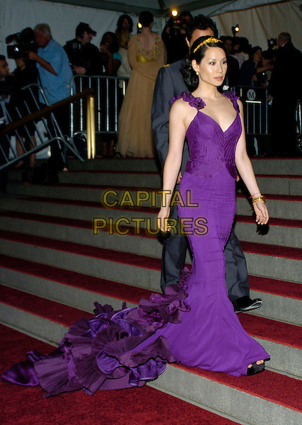 "LUCY LIU.2007 Metropolitan Museum of Art Costume Institute Gala celebrating ""Poiret: King of Fashion"" exibition at the Metropolitan Museum of Art, New York City, New York, USA..May 7th, 2007.full length purple dress headband ruffles layers gathered pleated .CAP/ADM/BL.©Bill Lyons/AdMedia/Capital Pictures *** Local Caption ***"