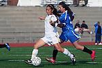 Torrance, CA 02/08/10 - Lauren Kai (West #18)'s kick on goal added another score for West as Leuzinger's Serena Gonzalez (Leuzinger #3) trails her.