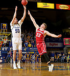 BROOKINGS, SD - FEBRUARY 23: David Wingett #50 of the South Dakota State Jackrabbits shoots a three pointer against Tyler Peterson #22 of the South Dakota Coyotes Sunday at Frost Arena in Brookings, SD. (Photo by Dave Eggen/Inertia)