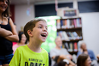 NWA Democrat-Gazette/CHARLIE KAIJO Landon Kennedy, 4, of Bella Vista laughs during a magic show, Thursday, July 5, 2018 at the Bella Vista Public Library in Bella Vista. <br /><br />Tommy Terrific performed a musical magic show for youth.