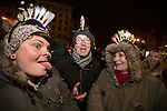 © Joel Goodman - 07973 332324 . 31/12/2013 . Manchester , UK . L-R daughter Jenny Dean (32) , dad Paul Todd (54) and mum Pam Parton (55) (all from Reddish) . Revellers gather in Piccadilly Gardens ahead of the New Years fireworks display to usher in 2014 . Photo credit : Joel Goodman