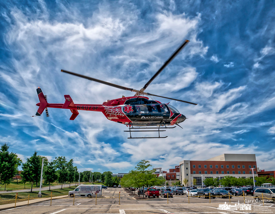 The Mt. Carmel Survival Flight helicopter lifts off from the St. Ann's Hospital helipad after a public relations visit to the complex on Cleveland Avenue.