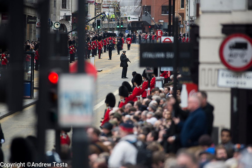 UK. London. 17th April 2013..A armed policeman on the route of Margaret Thatcher's funeral procession..©Andrew Testa/Panos