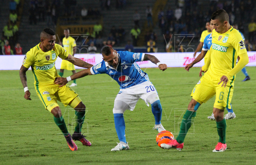 BOGOTA -COLOMBIA, 7-06-2017. Juan G. Dominguez player of Millonarios fights the ball  agaisnt of  Arley Rodriguez player of Atletico Nacional .Action game between  Millonarios  and Atletico Nacional during match for quarter finals of the Aguila League I 2017 played at Nemesio Camacho El Campin stadium . Photo:VizzorImage / Felipe Caicedo  / Staff