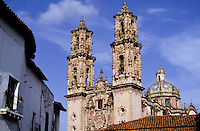 "Taxco de Alarcón (usually referred to as simply ""Taxco"") is a small city and municipality located in the Mexican state of Guerrero. The name Taxco is most likely derived from the Nahuatl word tlacheco, which means ""place of the ballgame."" However, one interpretation has the name coming from the word tatzco which means ""where the father of the water is,"" due to the high waterfall near the town center on Atatzin Mountain. ""De Alarcón"" is in honor of writer Juan Ruiz de Alarcón who was a native of the town. Like many municipalities in central Mexico, the municipality's coat-of-arms is an Aztec glyph. This glyph is in the shape of a Mesoamerican ballcourt with rings, players and skulls, derived from the most likely source of Taxco's name.[1].The city is heavily associated with silver, both with the mining of it and other metals and for the crafting of it into jewelry, silverware and other items. This reputation, along with the city's picturesque homes and surrounding landscapes have made tourism the main economic activity as the only large-scale mining operation here is coming to a close.[2][3].Taxco is located in the north-central part of the state, 36 km from the city of Iguala, 135 km from the state capital of Chilpancingo and 170 km southwest of Mexico City. The city was named one of Mexico's ""Pueblos Mágicos"" (Magical Towns) due to the quality of the silverwork, the colonial constructions and the surrounding scenery.[2][4]"