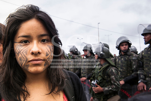 The United Nations Conference on Sustainable Development (Rio+20), Rio de Janeiro, Brazil, 21st June 2012. Young woman with traditional face paint in front of the Army shock troops. Photo © Sue Cunningham.