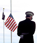A U.S. Marine bugler bows his head as the American Flag is lowered to half mast at the Sayreville Boro Town Hall as veterans held a memorial service for Sayreville's James Pagie Jr. whom was killed while trying to save his fellow Marines in a helicopter crash during a training exercise.