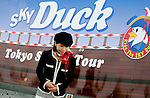 "November 14, 2011 : Tokyo, Japan - A tour guide of Amphibian Bus Sky Duck is waiting for customers during the press conference of ""Tokyo's First Amphibian Bus Sky Duck"" at the Wakasu Kaihin park in Tokyo. Hinomaru Limousine Inc. announced Tokyo's new way of sightseeing Sky Duck bus tour. Tokyo is one of the greatest tourism places in the world, and they would like to emphasis Tokyo as a city of waterways for the next step. In addition, this bus would be used as a delivery car when any national disaster happens. (Photo by Yumeto Yamazaki/AFLO)"