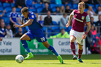 Nathaniel Mendez-Laing of Cardiff City gets away from Glenn Whelan of Aston Villa during the Sky Bet Championship match between Cardiff City and Aston Villa at the Cardiff City Stadium, Cardiff, Wales on 12 August 2017. Photo by Mark  Hawkins / PRiME Media Images.