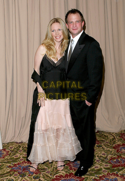 LAURALEE BELL & HUSBAND SCOTT.Saks Fifth Avenue's Unforgettable Evening.Benefiting Women's Cancer Research Fund.held at the Regent Beverly Wilshire Hotel, Beverly Hills, USA, 1st March 2005..full length black sheer vest top camisole married wife cream layered skirt.Ref: ADM.www.capitalpictures.com.sales@capitalpictures.com.©JWong/AdMedia/Capital Pictures .