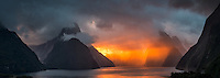 Dramatic sunset over Milford Sound with Mitre Peak 1692m in clouds, Fiordland NP, Southland, World Heritage Area, New Zealand, NZ
