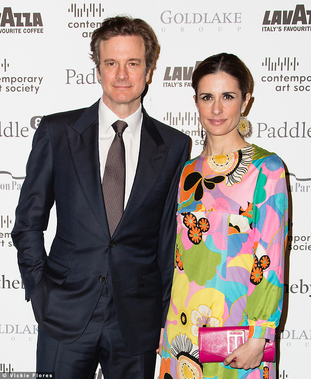 Colin Firth and Livia Giuggoili arrive for the Contemporary Art Society Fundraising Gala at Tobacco Dock in Wapping, East London on March 11, 2014.