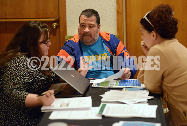 BRISTOL, PA -  OCTOBER 20: From left, Emily Lennon helps Albert Rodriguez and his girlfriend Kim Stiltner, both of Bristol, Pennsylvania sign up for the Affordable Healthcare Act October 20, 2013 in Bristol, Pennsylvania. Representatives of Resource of Human Development made a presentation and answered questions about the Affordable Healthcare Act and helped sign people into the program for health insurance. (Photo by William Thomas Cain/Cain Images)