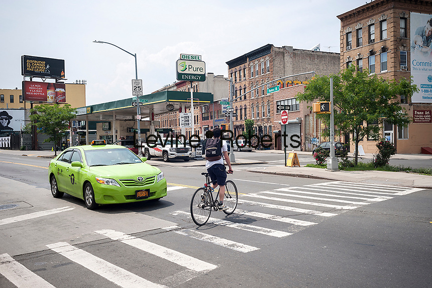Flushing Avenue intersection in the Bushwick neighborhood in Brooklyn in New York on Saturday, June 4, 2016. The neighborhood has undergone gentrification changing from a rough and tumble mix of Hispanic and industrial to a haven for hipsters, forcing many of the long-time residents out because of rising rents.. (©Richard B. Levine)