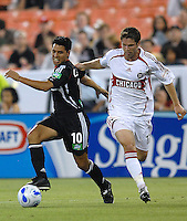 DC United midfielder Christian Gomez (10)  battles Chicago Fire defender Logan Pause (12) for the ball. DC United defeated the Chicago Fire 1-0, Wednesday, June 21, 2006.