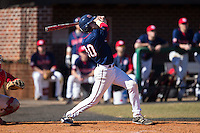 Jake Kennedy (30) of the Shippensburg Raiders follows through on his swing against the Belmont Abbey Crusaders at Abbey Yard on February 8, 2015 in Belmont, North Carolina.  The Raiders defeated the Crusaders 14-0.  (Brian Westerholt/Four Seam Images)