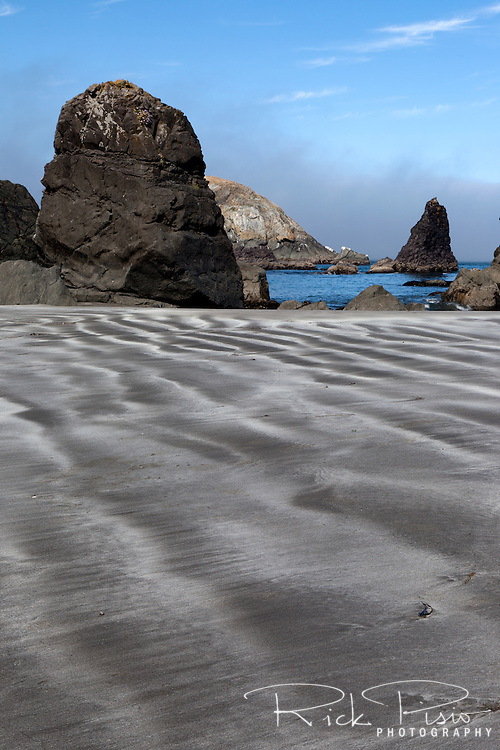 Striations in the sand at Rainbow Rock Beach near Brookings Oregon are exposed at low tide.
