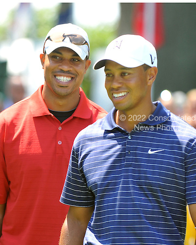 Bethesda, MD - July 1, 2009 -- Washington Redskins quarterback Jason Campbell, left, and Tiger Woods, right, pose for photos follow the opening ceremony of the AT&T National Hosted by Tiger Woods at Congressional Country Club in Bethesda, Maryland on Wednesday, July 1, 2009..Credit: Ron Sachs / CNP