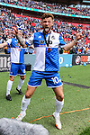 Matt Taylor of Bristol Rovers celebrates victory in the 2015 Vanarama Conference Promotion Final as Ellis Harrison of Bristol Rovers takes a photograph of him with a remote camera left behind the goal after the match between Grimsby Town and Bristol Rovers at Wembley Stadium, London<br /> Picture by David Horn/eXtreme aperture photography +44 7545 970036<br /> 17/05/2015