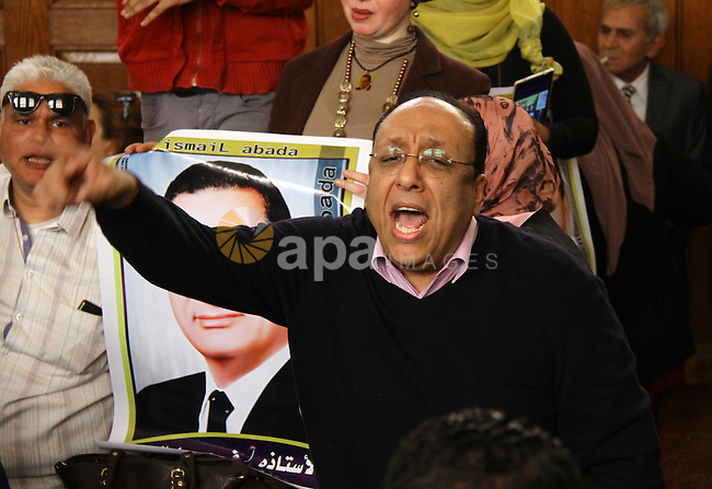 A supporter of former Egyptian president Hosni Mubarak shouts slogans at the High Court where Mubarak's trial will take place, in Cairo, Egypt, April 7, 2016. Photo by Stranger