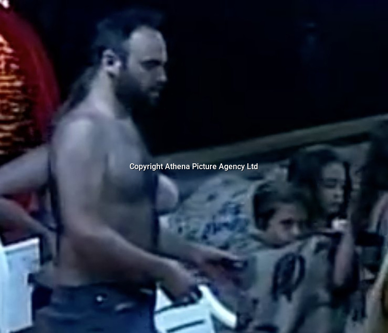 Pictured: Video grab of the live tv news bulletin showing the two girls on a rescue boat.<br /> Re: Two twin sisters Sofia and Vassiliki Filippopoulou who couldn't be located by their parents after the wild forest fire in the Mati area of Rafina in Greece, have seen them on live tv,<br /> Their father Giannis Filippopoulos has described how he and his wife were frantically searching for them and even went to the morgue to be DNA swabbed without success. They then saw their two twin daughters being transferred by boat to safety but claim their names were not recorded. They had gone to the area with their grandparents Filippos and Sofia for their summer holiday.