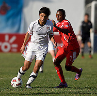 Alejandro Guido (10) of the United States sprints past Dario Wright (7) of Panama during the group stage of the CONCACAF Men's Under 17 Championship at Jarrett Park in Montego Bay, Jamaica. The USA defeated Panama, 1-0.