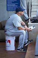 Xavier Musketeers head coach Scott Googins (7) sits in the dugout during the game against the Penn State Nittany Lions at Coleman Field at the USA Baseball National Training Center on February 25, 2017 in Cary, North Carolina. The Musketeers defeated the Nittany Lions 10-4 in game one of a double header. (Brian Westerholt/Four Seam Images)