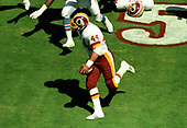 Washington Redskins running back John Riggins (84) carries the ball during the game against the Houston Oilers at RFK Stadium in Washington, DC on September 16, 1985.   The Redskins won the game 16 - 13.<br /> Credit: Howard L. Sachs / CNP