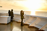 CANADA, Vancouver, British Columbia, passengers enjoy the views at sunset off the Holland America Cruise Ship, the Oosterdam, while it sails through Discovery Passage in the Inside Passage