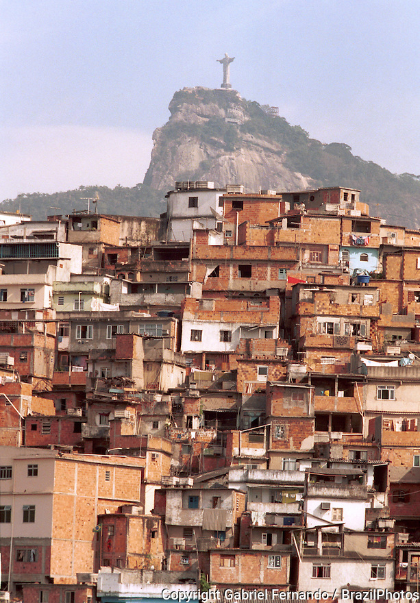 Rio de Janeiro favela - Morro da Coroa ( Coroa slum ) at Santa Teresa quarter, Brazil - Christ the Redeemer and Corcovado mountain in the background.