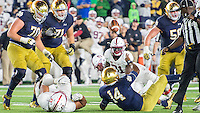 DeShone Kizer (14) attempts to pass the ball after being sacked by Stanford Cardinal defensive end Solomon Thomas (90) on the final play of the game.