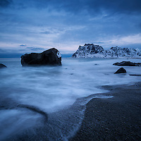 Rocky shore of Uttakleiv beach in winter, Vestvågøy, Lofoten Islands, Norway