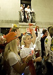 Revellers raise red scarves and candles as they sing 'Pobre de Mi' during the end of the San Fermin Festival on July 15, 2014, in Pamplona, Basque Country. Every year, tens of thousands of people pack Pamplona's streets for a drunken kick-off to one os worls's best-known fiesta: the nine-day San Fermin bull-running festival. (Ander Gillenea / Bostok Photo)