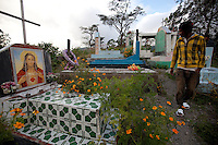 May 3rd, 2012_ LACLUBAR, TIMOR-LESTE_ A young man walks through a grave yard in the Suco of Batara in the mountain town of Laclubar, Timor-Leste.  Photographer: Daniel J. Groshong/The Hummingfish Foundation
