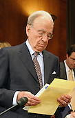 """News Corporation Chairman and CEO Rupert Murdoch studies his notes before the United States Senate Committee on the Judiciary Subcommittee on Antitrust, Competition, and Business and Consumer Rights hearing on """"The NewsCorp/Direct TV Deal: The Marriage of Content and Global Distribution"""" in Washington, DC on June 18, 2003.."""