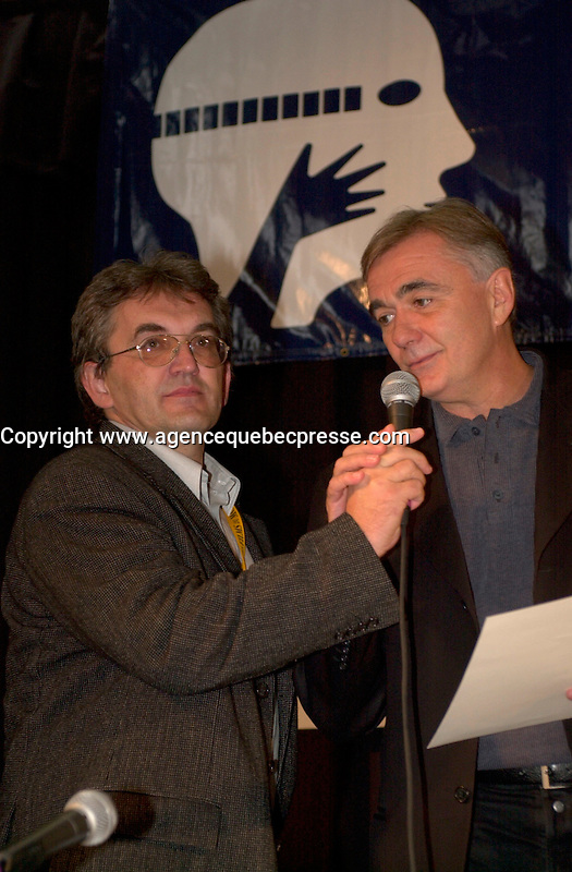 Sept 7,  2003, Montreal, Quebec, Canada<br /> <br /> Serbian-Montenegro film maker Dusan Kovacevic (R)<br /> and translator (L) thanks the FIPRESCI Jury after receiving an the FIPRESCI AWard for his movie THE PROFESSIONAL (PROFESIONALAC) <br /> <br /> <br /> The Festival runs from August 27th to september 7th, 2003<br /> <br /> <br /> Mandatory Credit: Photo by Pierre Roussel- Images Distribution. (&copy;) Copyright 2003 by Pierre Roussel <br /> <br /> All Photos are on www.photoreflect.com, filed by date and events. For private and media sales
