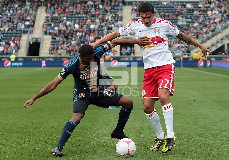 CHESTER, PA - OCTOBER 27, 2012:  Raymon Gaddis (28) of the Philadelphia Union holds off  Tim Cahill (17) of the New York Red Bulls during an MLS match at PPL Park in Chester, PA. on October 27. Red Bulls won 3-0.