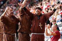 Swansea City fans dress up as monks in honour of their manager during the Barclays Premier League match between Southampton v Swansea City played at St Mary's Stadium, Southampton