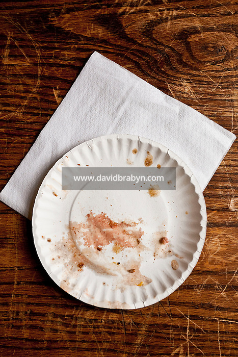 View of an empty paper plate and napkin on a table at Louis' Lunch hamburger joint in New Haven, CT, USA, 26 May 2009.